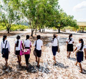 Justin-Mott-Song-Saa-Foundation-cambodian-students-girls-walking-to-class-school-2015 copy
